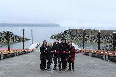 Members of city council cut ribbon to reopen the popular boat ramp.