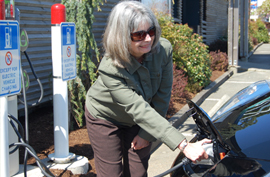 Local electric vehicle owner Kathy Denton charges her Nissan Leaf at the Visitor Information Centre during the City Grand Opening of the charging stations on Earth Day  - April 22, 2013
