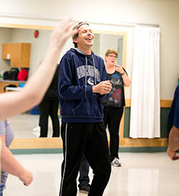 Please note: photo is of specialized recreation program participant Dave Marsters enjoying Zumba before COVID-19.